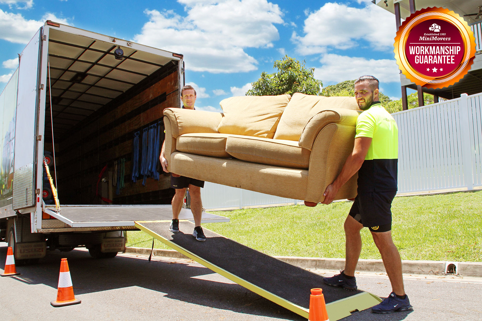 MiniMovers removalists loading a furniture into the truck