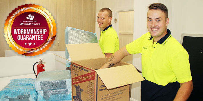 Removalists packing things inside MiniMovers Boxes