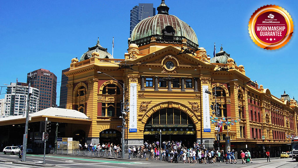 Flinders Street Station in Melbourne and a MiniMovers Workmanship Guarantee Badge